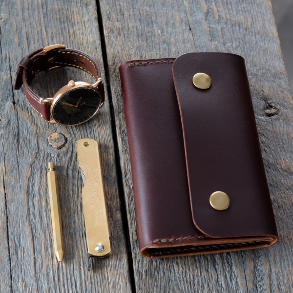 Rivet & Chain leather notebook wallet and matching brass accessories