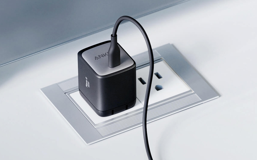 Anker Nano II charger's small footprint when plugged in