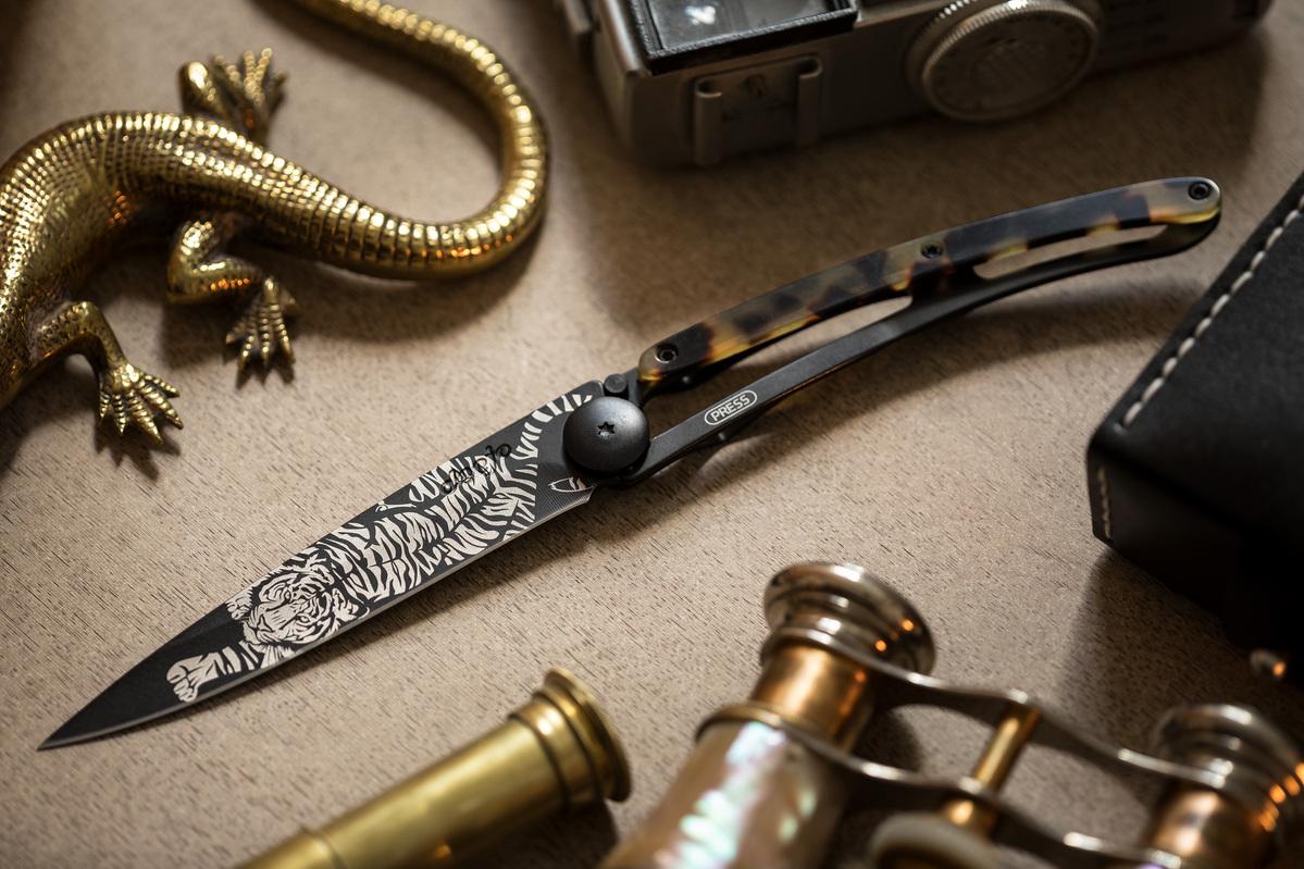 Deejo knife customized with blade tattoo